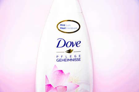 February 2020. Ukraine, Kramatorsk. Dove Pflege Geheimnisse Female shower gel on a white background. Shampoo for women's hair Redactioneel