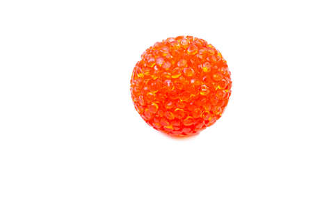 Bright red, orange ball for cats in macro on a white background