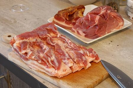 fresh raw meat on wooden board Stock Photo