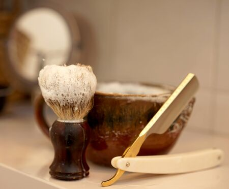 razor, shaving brush and foam dish in the bathroom Stock fotó - 142161678