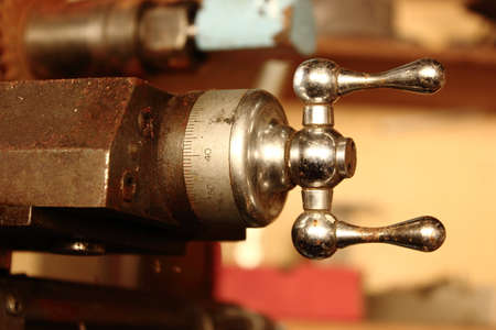 adjuster: An Old Rusted Lathe Dial Showing the Numbers to Set the Dial while Turning the Chrome Adjuster Stock Photo