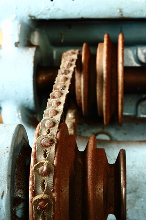 A Retro Reinforced Rusted Riveted Belt and Driven by Pulley Wheels Mounted on a Manual Lathe Machine