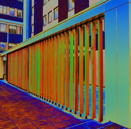 louver: A Colour Manipulated Image of a New Building Fence Barrier to Obscure Exterior Objects with Angled Wooden Venting Slats