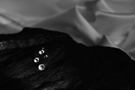 In and Out of Focus Scattered Diamonds Showing the Facet Cut of the Gem