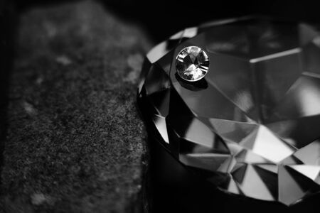 energy healing: In and Out of Focus Scattered Diamonds Showing the Facet Cut of the Gem