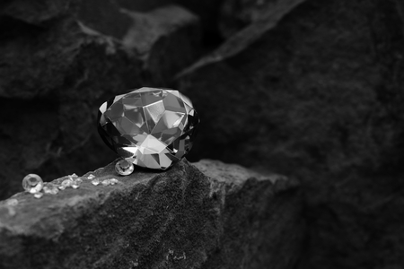 A Single Large Gem Stone on Top of a Rock with Diamonds at the Base of the Gem Stock Photo