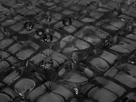 In and Out of Focus Scattered Diamonds on a Bed of Ice Cubes, Showing the Facet Cut of the Gem Stone. Banco de Imagens