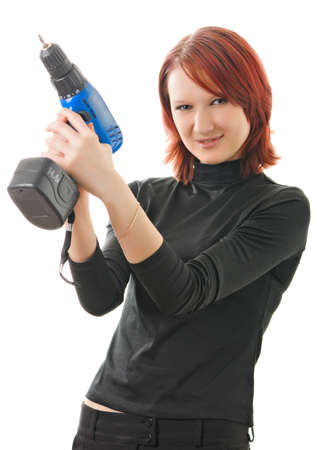 a young beautiful girl with a drill in the hands photo