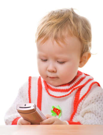 kid with a smartphone in the hands on a white background photo