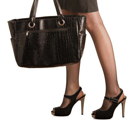 a girl with beautiful leg steps to the shop with a big bag