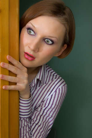 appalled: a girl looking out of the corner in horror Stock Photo
