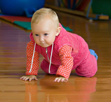 baby to crawl on the floor and with interest looks all around Stock Photo