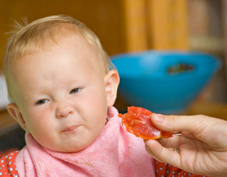 A child who refuses to eat and crumple Stock Photo