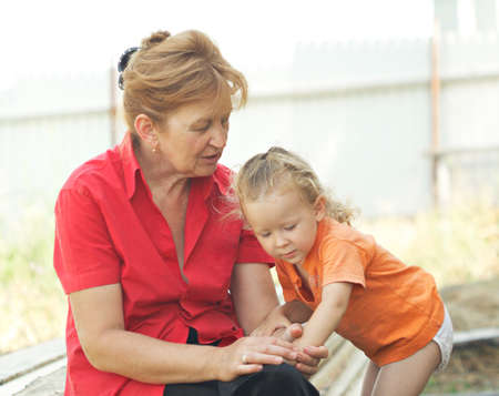 Grandmother and granddaughter. Very emotional picture. Shallow DOF. Stock Photo - 7476734