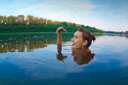 beautiful young girl with a bright emotions swimming in the river Stock Photo - 7476777