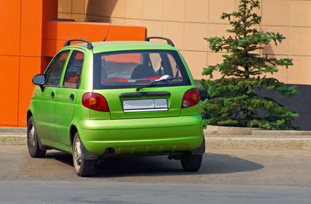 pragmatic: The modern compact car - a symbol of economy and practicality. Stock Photo