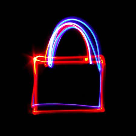 Freezelight photo depicting the contours of the lock on a black background. Stock Photo