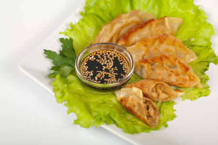 Japanese gyoza with shrimp on a white plate