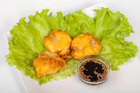 The japanese tempura hotate on a white plate