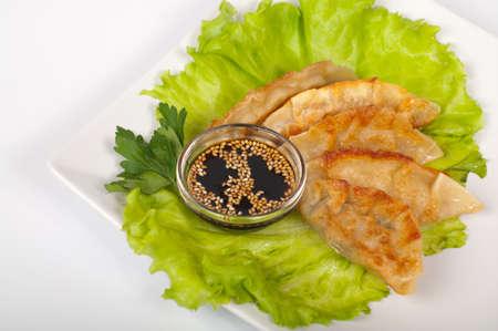 Japanese traditional gyoza on a white plate