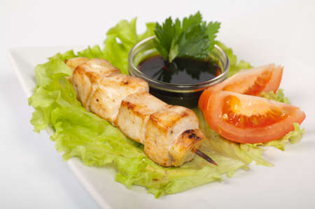 Japanese yakitori chicken on a white plate