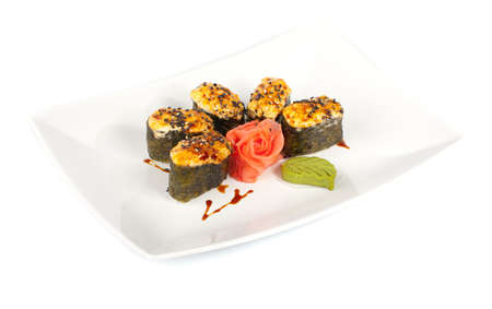 Baked sushi on a plate. The insulation on a white background.