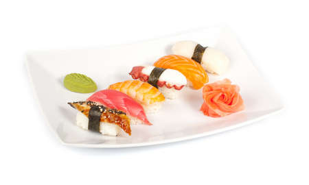 Sushi set with shrimp, eel, salmon, octopus, tuna, scallops on white.