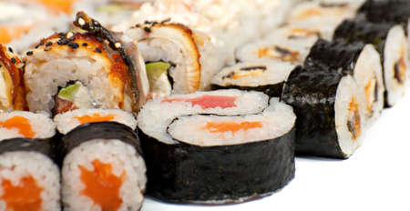 Sushi in the assortment on the white surface