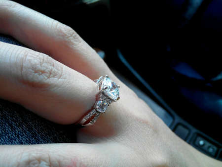 Beautiful ring on female finger. Closeup photo.  Foto de archivo