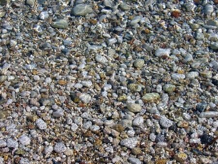 pebble stones under sea water, with water reflect over them Stock Photo - 3439492