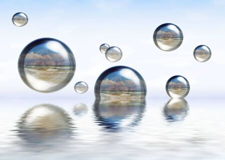 Glassy spheres reflecting beautiful beach, floating on the water photo