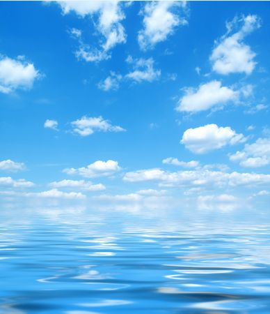 Bright blue sky and puffy white clouds reflecting on the water