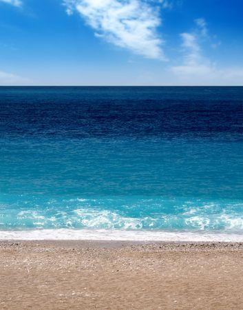 Oludeniz beach in turkey, sunshine, sand and waves photo