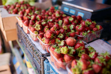 Strawberry on a farm market in the city. Fruits and vegetables at a farmers summer market.