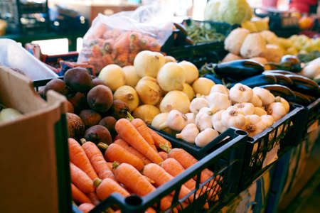 Fresh organic vegetables and fruits on sale at the local farmers summer market outdoors. Healthy organic food concept.