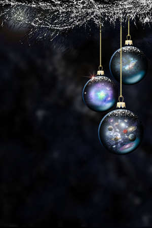 Space christmas baubles dark background Stock Photo