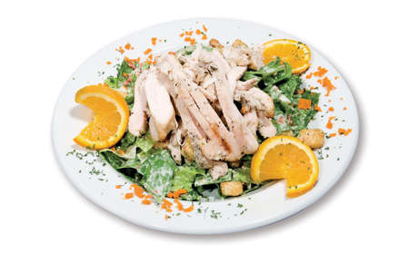 Grilled chicken caesar salad with croutons on a white background
