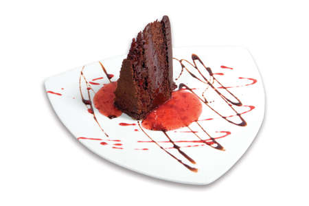 Slice of chocolate cake on a white background  Фото со стока