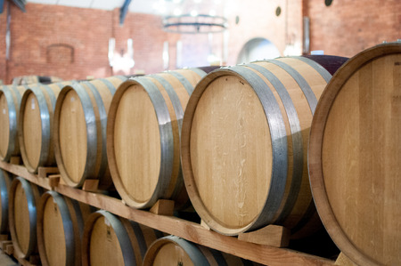 Casks barrels fermenting wine at winery brewery winemaking Stock Photo