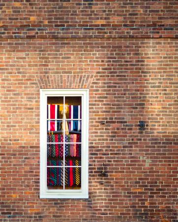 window of tie shop in brick building colorful