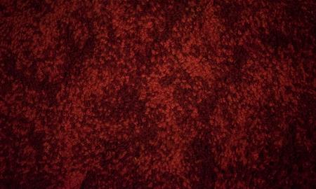 Red shag carpet texture closeup fiber texture