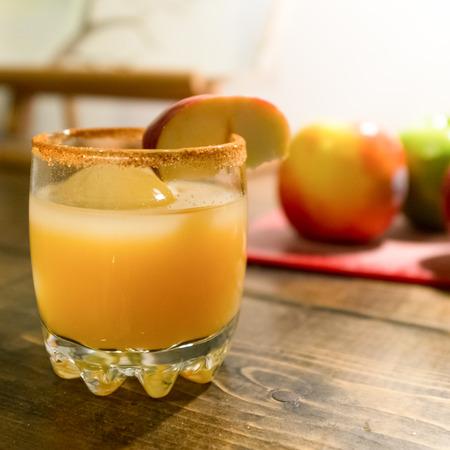 Alcoholic apple cider drink with apple garnish