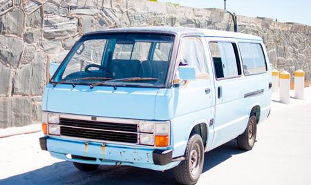 Old light blue van in africa rusting bus