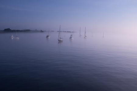 Morning fog in Salem harbor Massachusetts sailboats Stock Photo