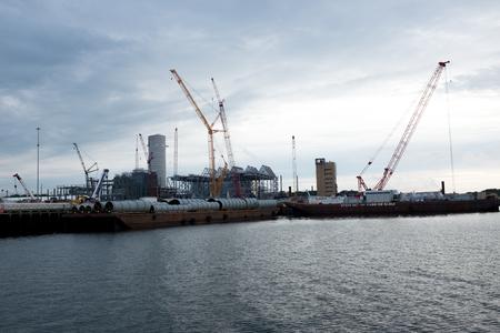 Cranes in boatyard in Salem Harbor Massachusetts