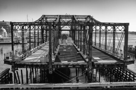 Closed footbridge in Bostons seaport district black and white Stock Photo