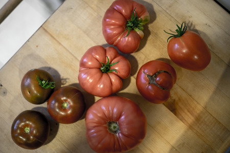 Homegrown tomatos from the garden on cutting board