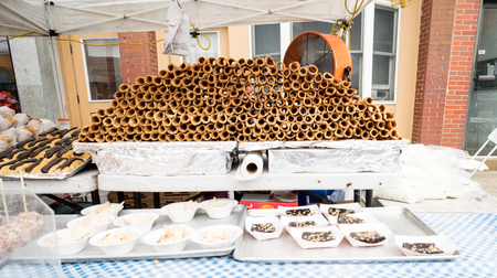 Pile of unfilled cannolis and other italian pasteries