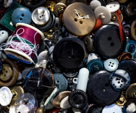 Pile of old buttons and thred background vintage messy