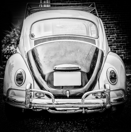 Old volkswagon beetle bug in black and white
